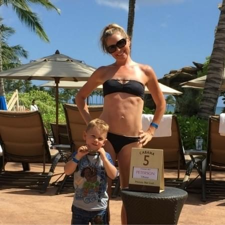 Summer Peterson with son on cabana